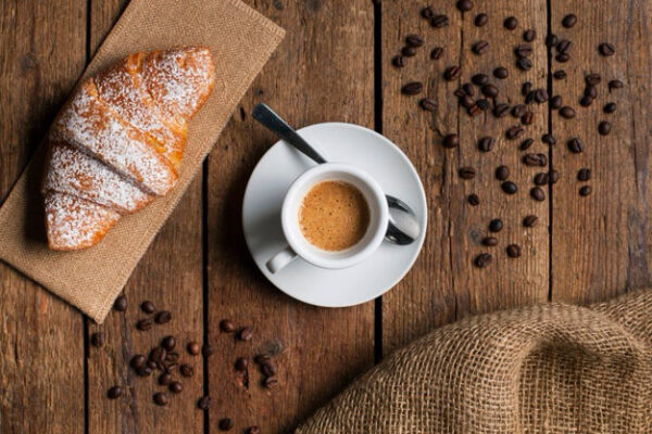 flat-lay-espresso-with-croissant-coffee-seeds_23-2148338647