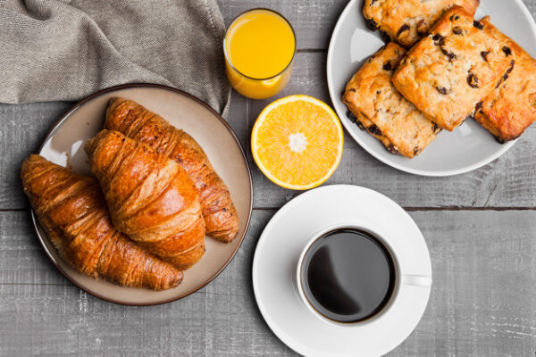 healthy-breakfast-with-coffee-juice-fruits-pastry-wooden-table_157173-706